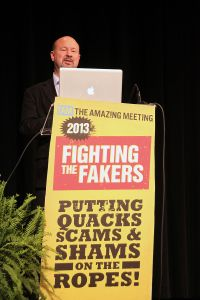 "Michael Mann speaking about ""The Hockey Stick and the Climate Wars"" at The Amaz!ng Meeting in Las Vegas, July 2013 (Source: Wikipedia)"