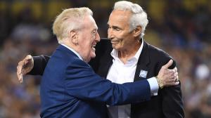 Vin Scully and Hall-of-Fame pitcher Sandy Koufax embrace during the pregame ceremony honoring the Dodgers broadcaster on Sept. 23, 2016. (Credit: L.A. Times)